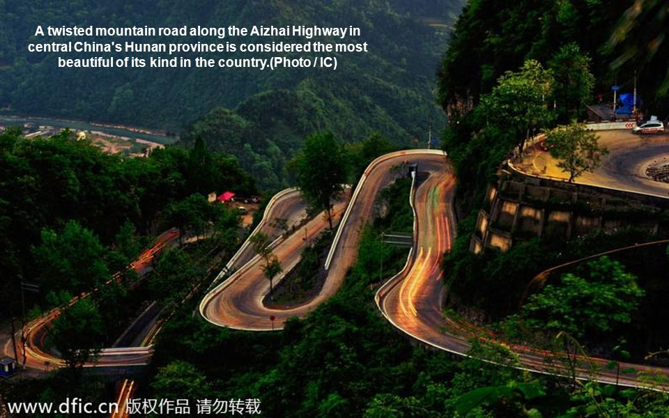 A twisted mountain road along the Aizhai Highway in central China s Hunan province is considered the most beautiful of its kind in the country.(Photo / IC)