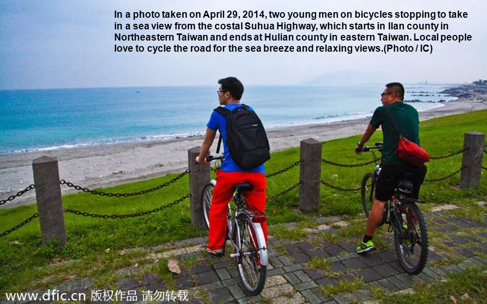 In a photo taken on April 29, 2014, two young men on bicycles stopping to take in a sea view from the costal Suhua Highway, which starts in Ilan county in Northeastern Taiwan and ends at Hulian county in eastern Taiwan.