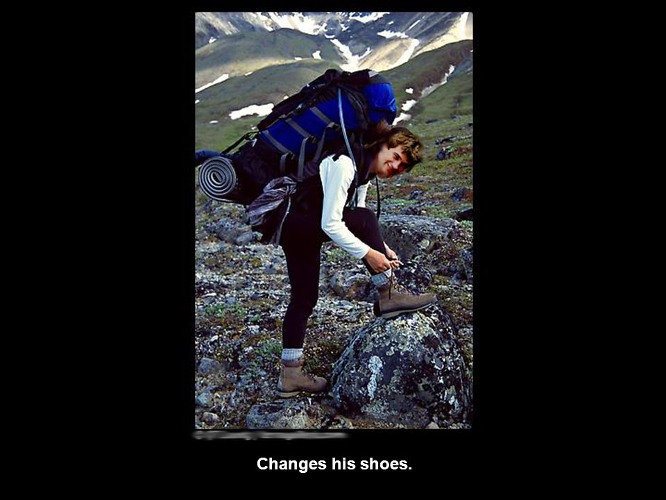 Changes his shoes.