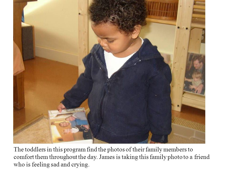 The toddlers in this program find the photos of their family members to comfort them throughout the day.