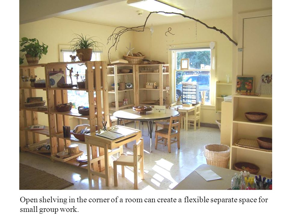 Open shelving in the corner of a room can create a flexible separate space for small group work.