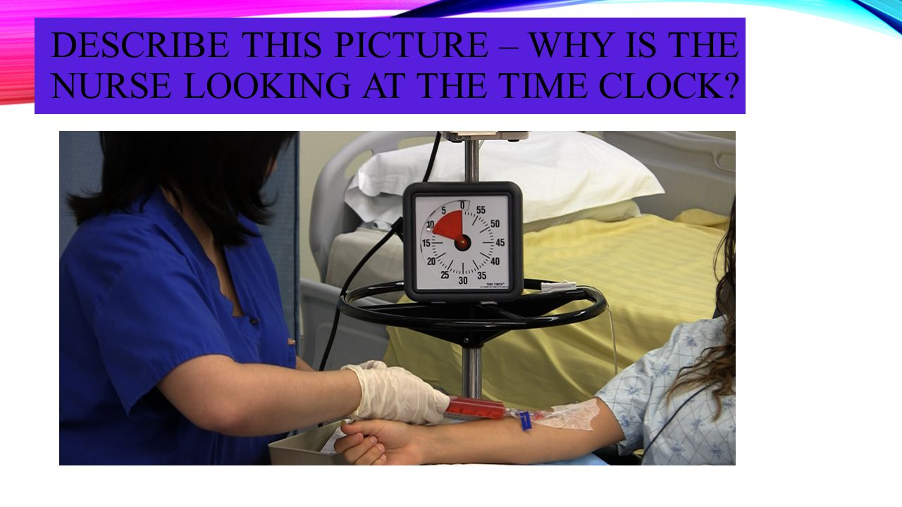 DESCRIBE THIS PICTURE – WHY IS THE NURSE LOOKING AT THE TIME CLOCK