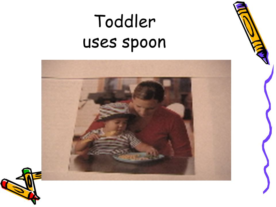 Toddler uses spoon