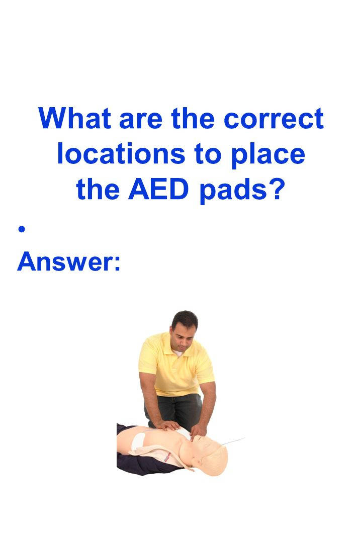 What are the correct locations to place the AED pads