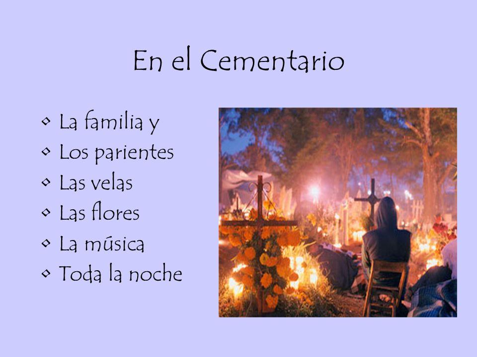 En el Cementario La familia y Los parientes Las velas Las flores