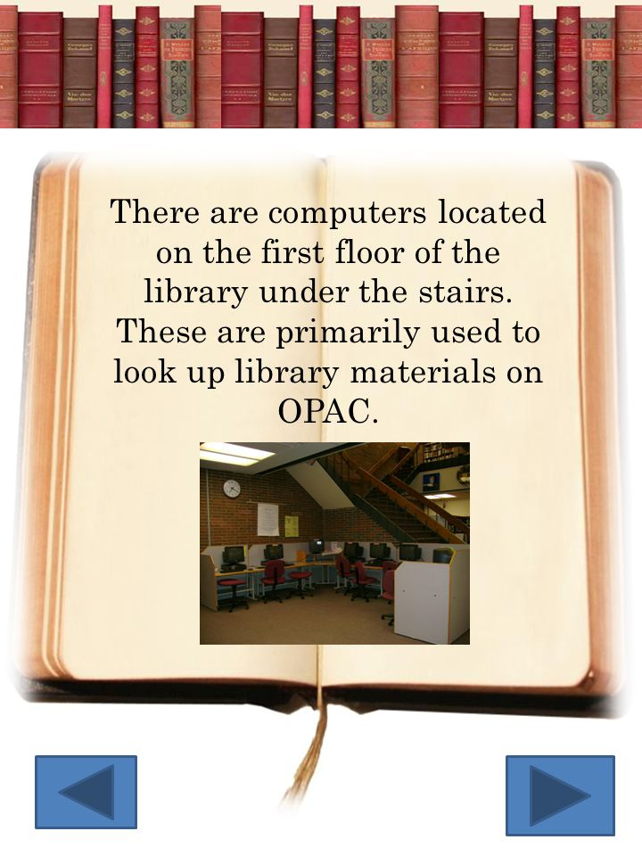 There are computers located on the first floor of the library under the stairs.