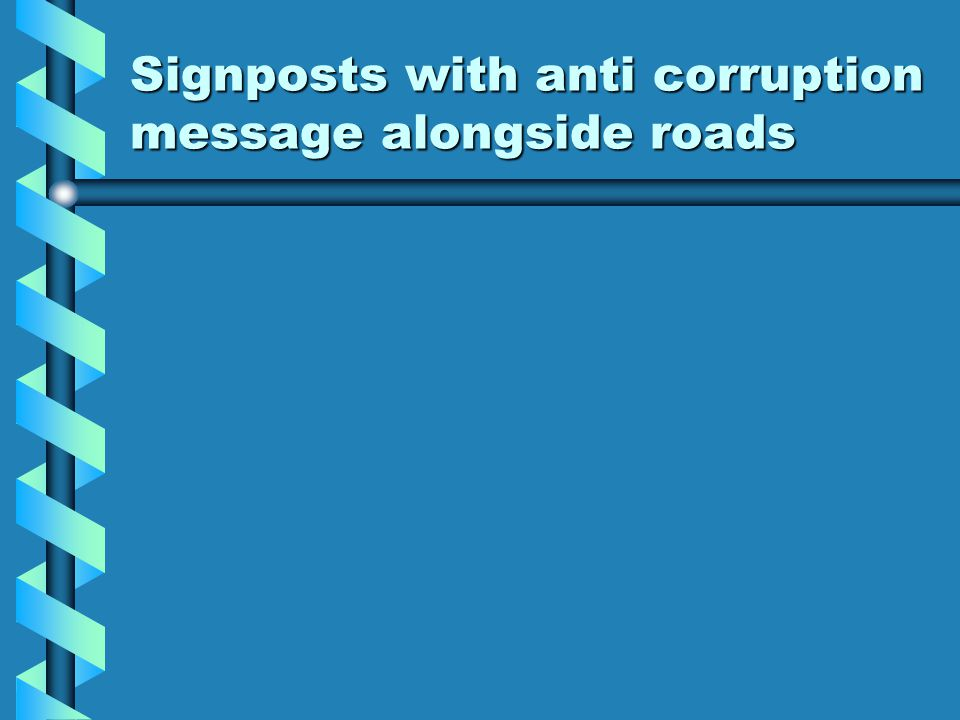 Signposts with anti corruption message alongside roads