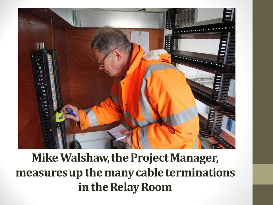 Mike Walshaw, the Project Manager, measures up the many cable terminations in the Relay Room