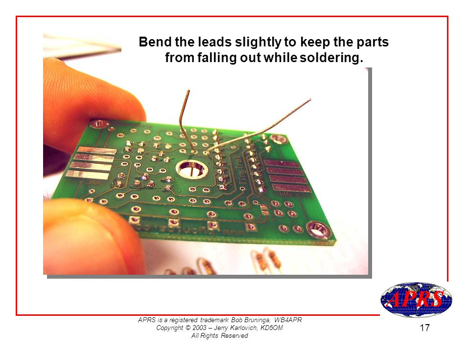 Bend the leads slightly to keep the parts from falling out while soldering.