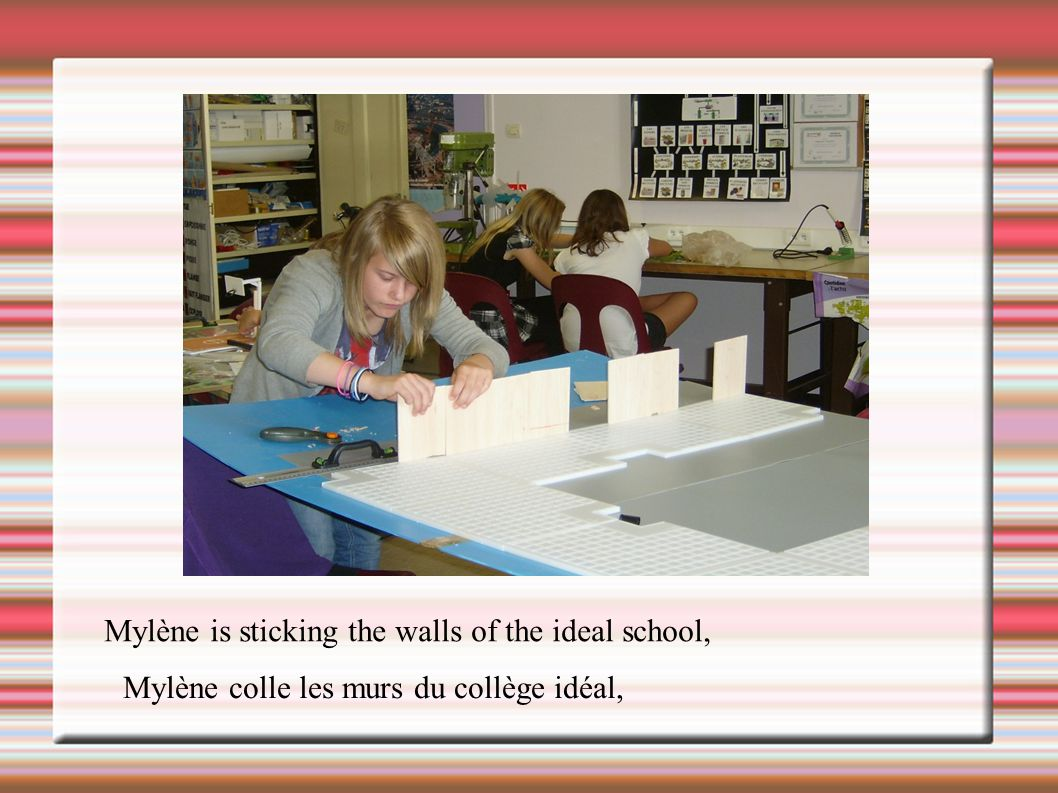 Mylène is sticking the walls of the ideal school,