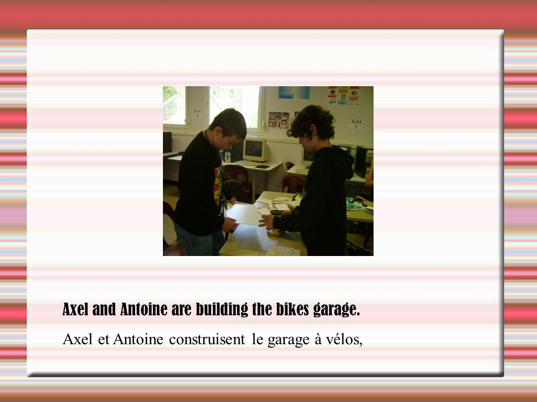 Axel and Antoine are building the bikes garage.