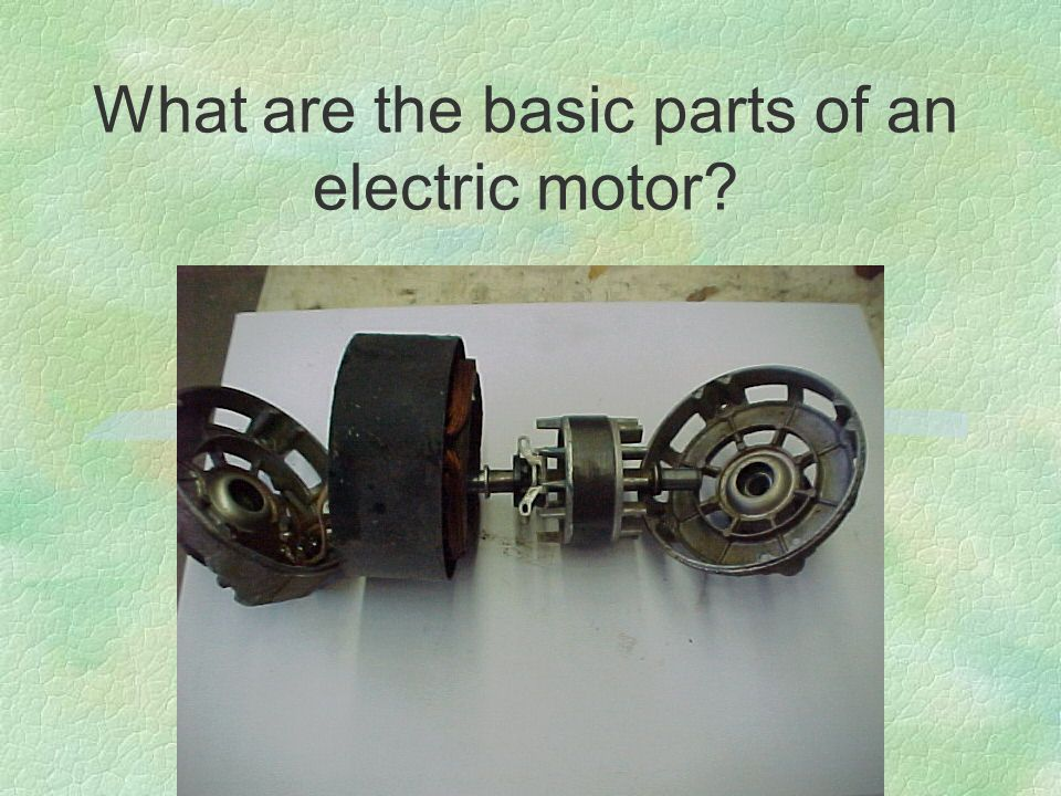 What are the basic parts of an electric motor