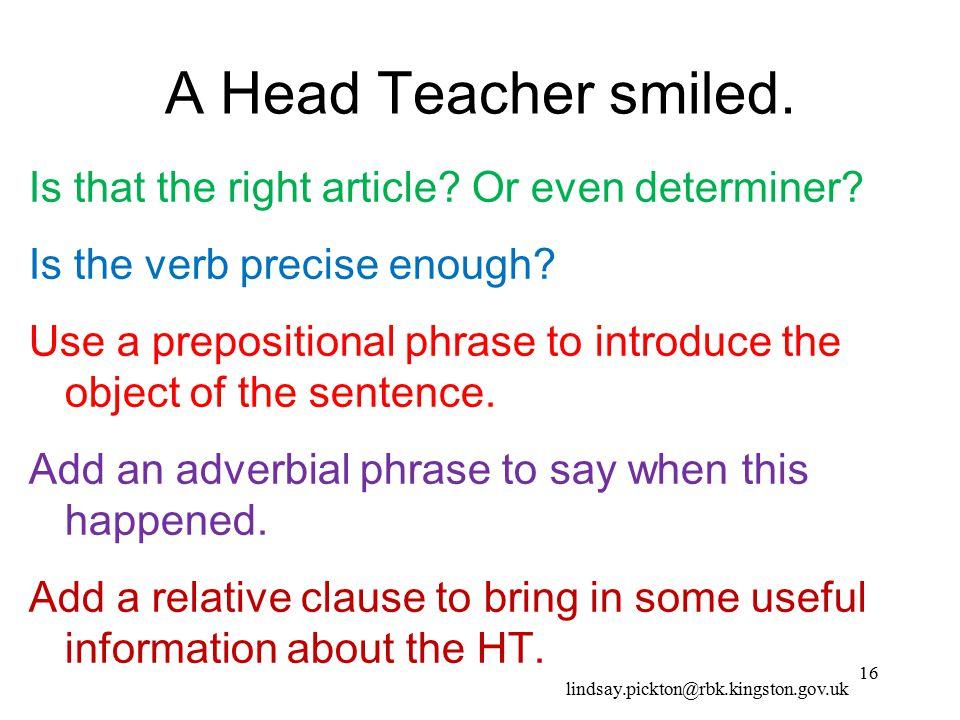 A Head Teacher smiled.