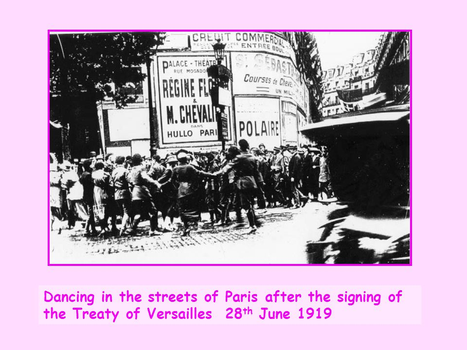 Dancing in the streets of Paris after the signing of the Treaty of Versailles 28th June 1919