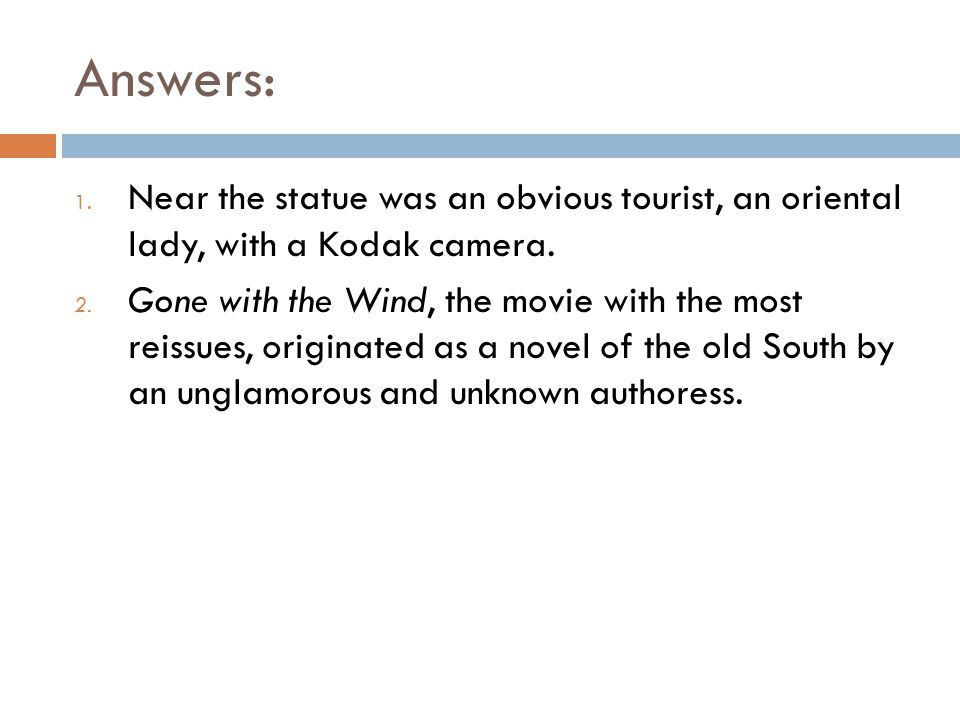 Answers: Near the statue was an obvious tourist, an oriental lady, with a Kodak camera.