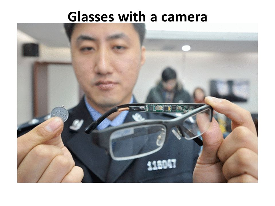 Glasses with a camera These glasses contain a hidden camera while a coin has a tiny receiver.