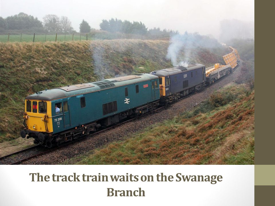 The track train waits on the Swanage Branch
