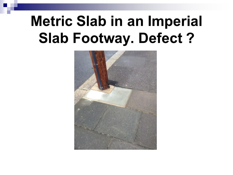 Metric Slab in an Imperial Slab Footway. Defect