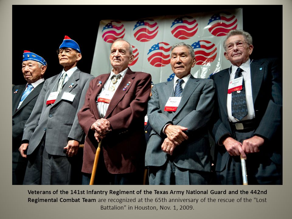 Veterans of the 141st Infantry Regiment of the Texas Army National Guard and the 442nd Regimental Combat Team are recognized at the 65th anniversary of the rescue of the Lost Battalion in Houston, Nov.