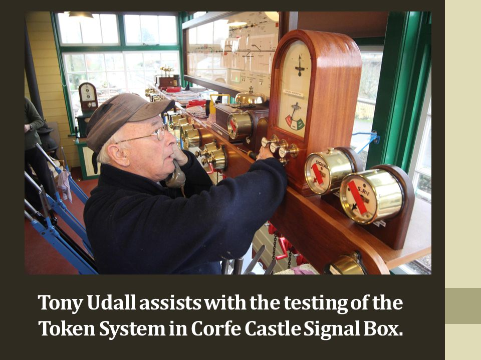 Tony Udall assists with the testing of the Token System in Corfe Castle Signal Box.