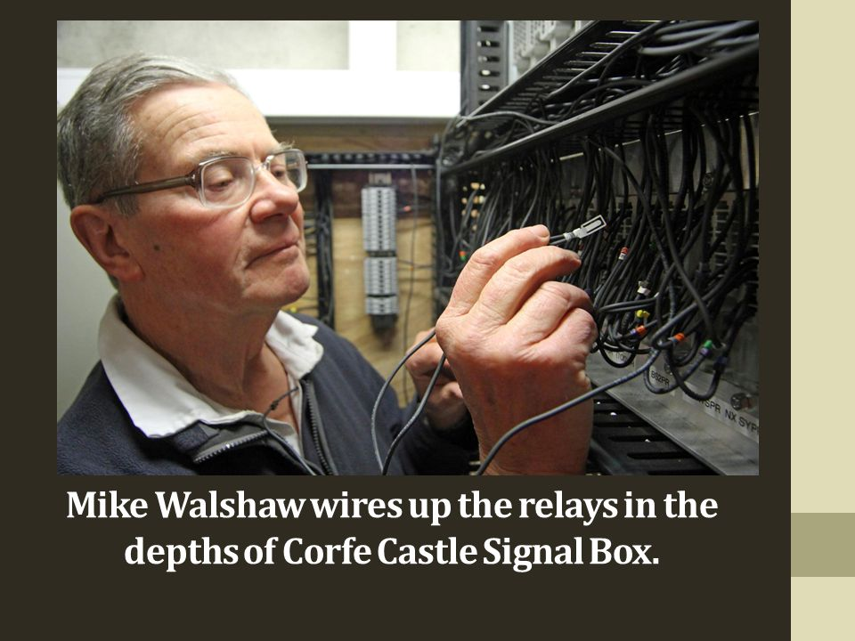 Mike Walshaw wires up the relays in the depths of Corfe Castle Signal Box.