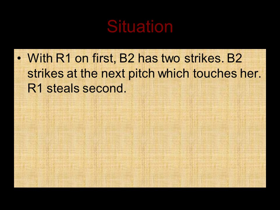 Situation With R1 on first, B2 has two strikes. B2 strikes at the next pitch which touches her.