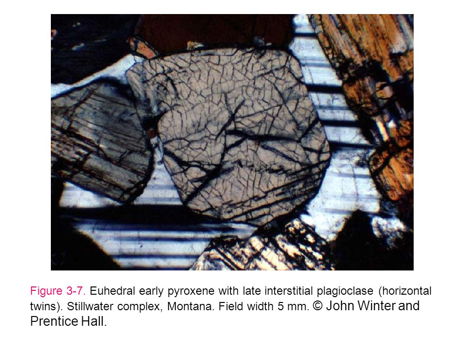 Figure 3-7. Euhedral early pyroxene with late interstitial plagioclase (horizontal twins).