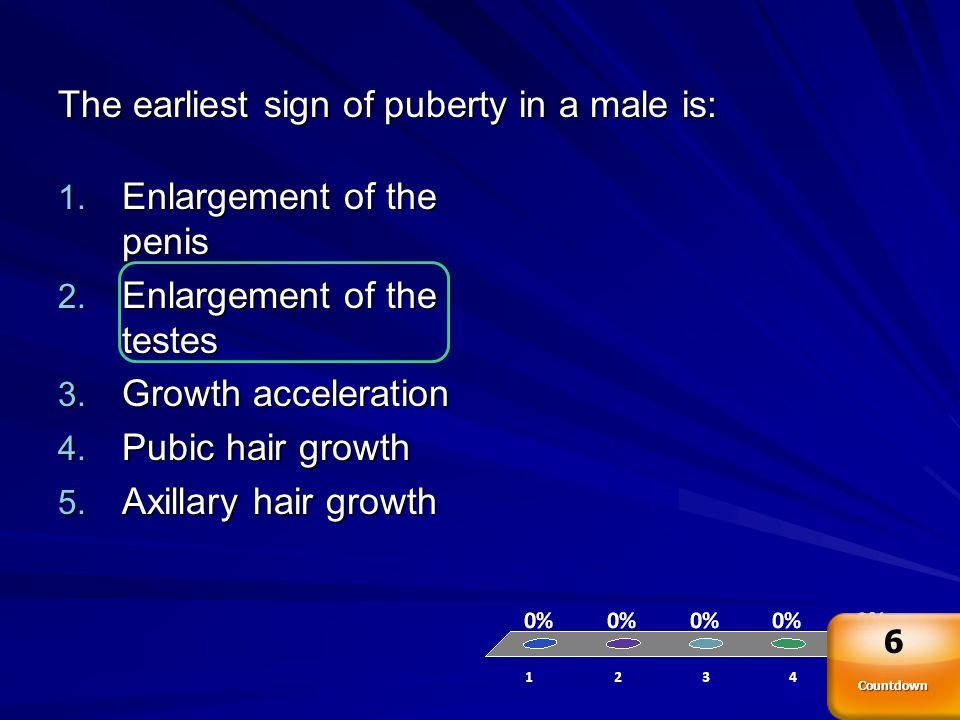 The earliest sign of puberty in a male is: