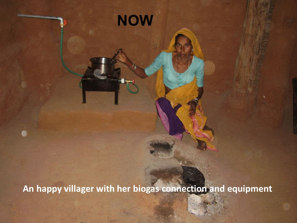 NOW An happy villager with her biogas connection and equipment