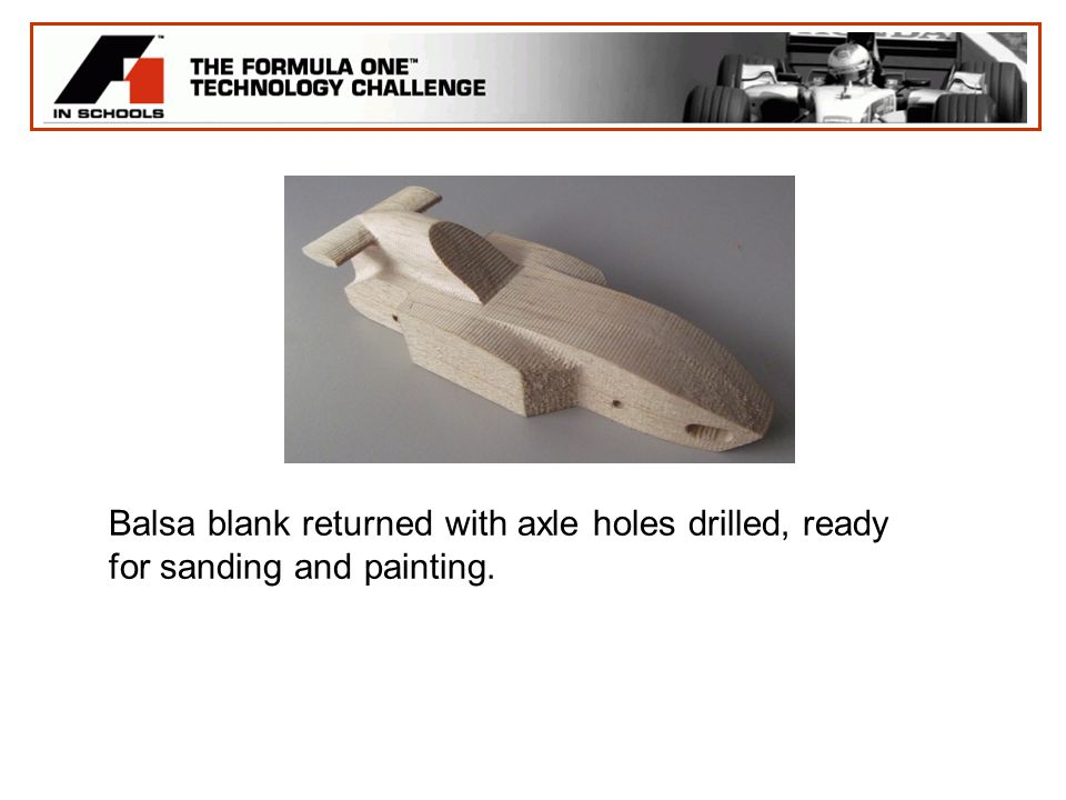 Balsa blank returned with axle holes drilled, ready