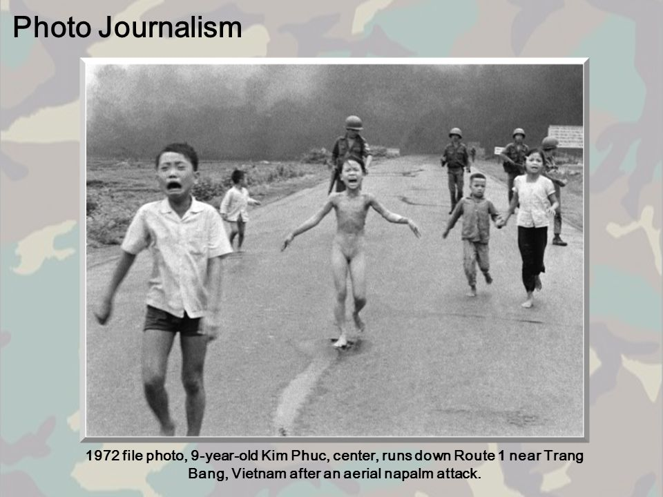 Photo Journalism 1972 file photo, 9-year-old Kim Phuc, center, runs down Route 1 near Trang Bang, Vietnam after an aerial napalm attack.