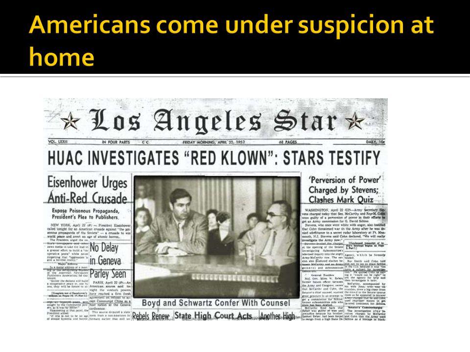 Americans come under suspicion at home