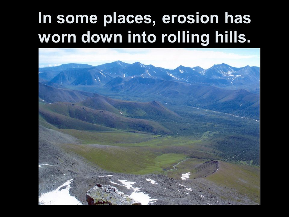 In some places, erosion has worn down into rolling hills.