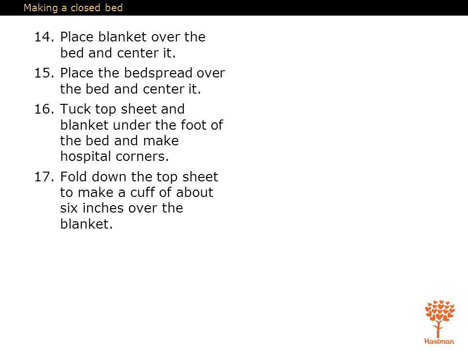 14. Place blanket over the bed and center it.