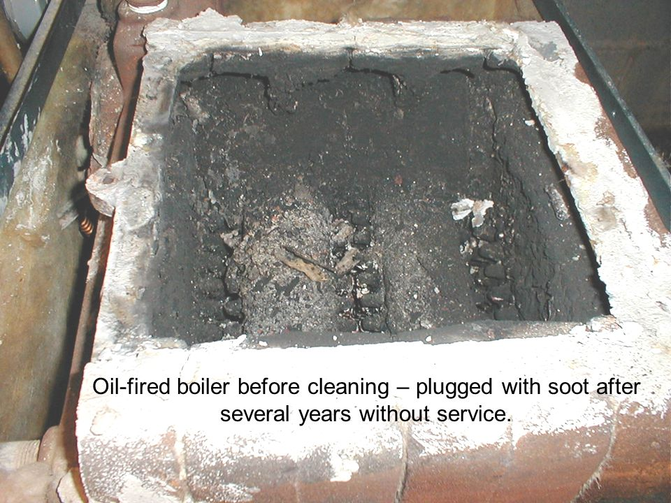 Oil-fired boiler before cleaning – plugged with soot after several years without service.