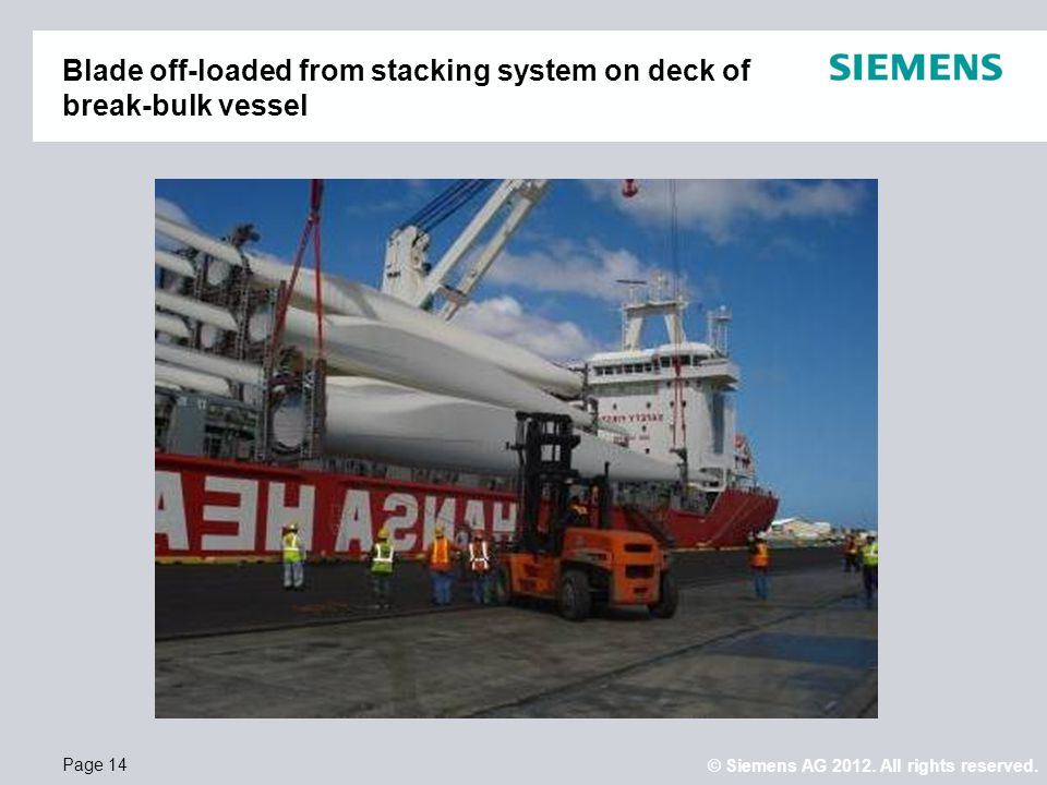 Blade off-loaded from stacking system on deck of break-bulk vessel