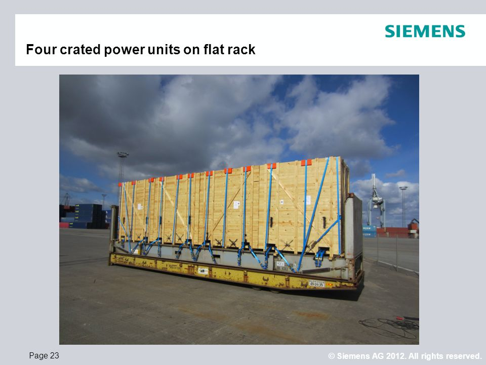 Four crated power units on flat rack