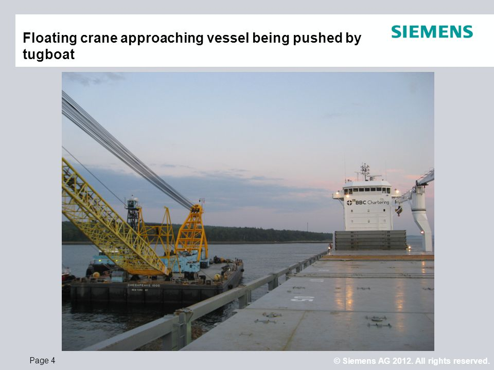 Floating crane approaching vessel being pushed by tugboat