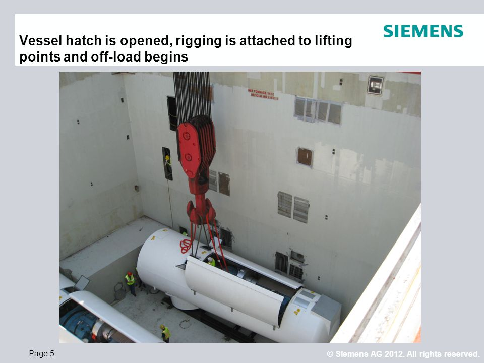 Vessel hatch is opened, rigging is attached to lifting points and off-load begins