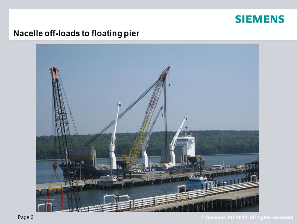 Nacelle off-loads to floating pier