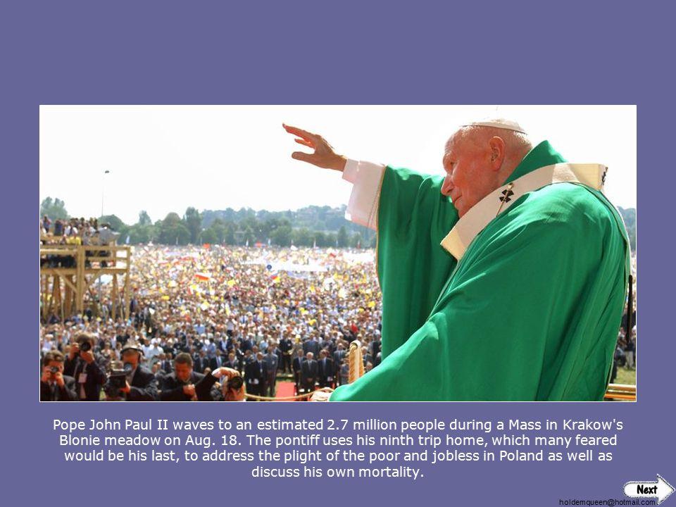 Pope John Paul II waves to an estimated 2