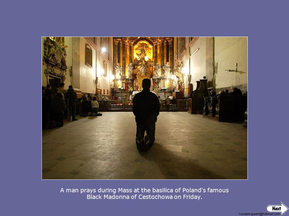 A man prays during Mass at the basilica of Poland s famous Black Madonna of Cestochowa on Friday.