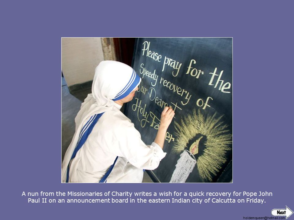 A nun from the Missionaries of Charity writes a wish for a quick recovery for Pope John Paul II on an announcement board in the eastern Indian city of Calcutta on Friday.