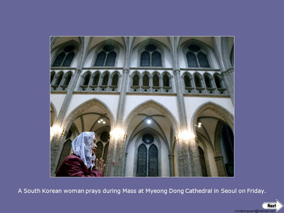 A South Korean woman prays during Mass at Myeong Dong Cathedral in Seoul on Friday.