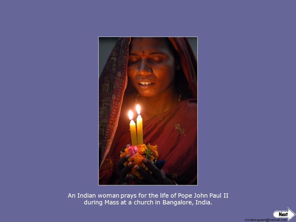An Indian woman prays for the life of Pope John Paul II during Mass at a church in Bangalore, India.