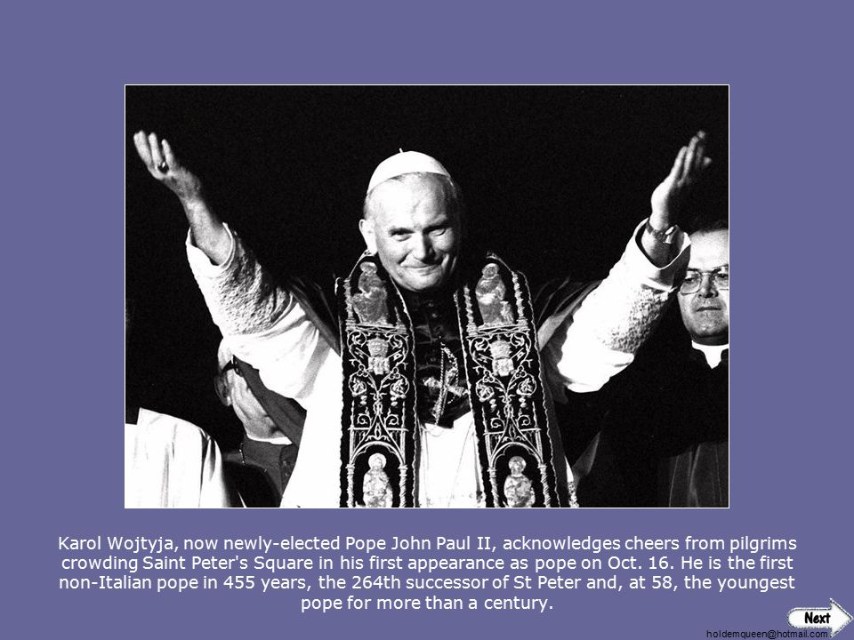 Karol Wojtyja, now newly-elected Pope John Paul II, acknowledges cheers from pilgrims crowding Saint Peter s Square in his first appearance as pope on Oct. 16. He is the first non-Italian pope in 455 years, the 264th successor of St Peter and, at 58, the youngest pope for more than a century.