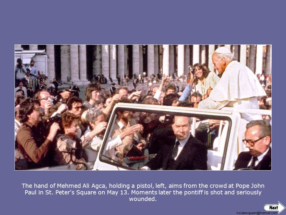 The hand of Mehmed Ali Agca, holding a pistol, left, aims from the crowd at Pope John Paul in St. Peter s Square on May 13. Moments later the pontiff is shot and seriously wounded.