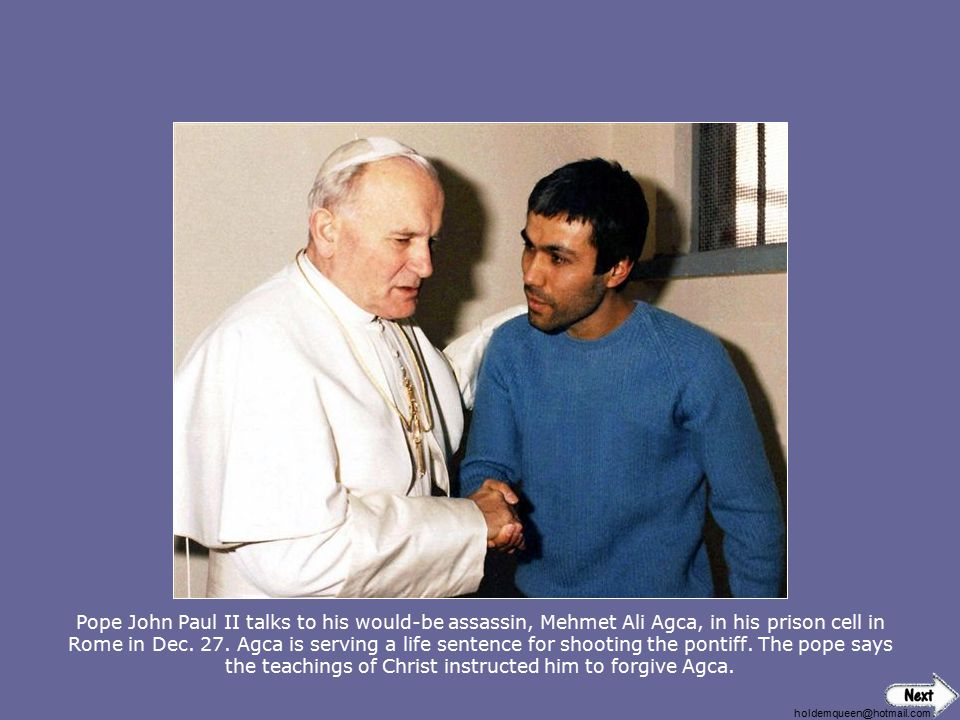 Pope John Paul II talks to his would-be assassin, Mehmet Ali Agca, in his prison cell in Rome in Dec. 27. Agca is serving a life sentence for shooting the pontiff. The pope says the teachings of Christ instructed him to forgive Agca.
