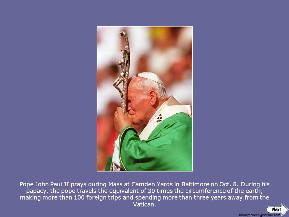 Pope John Paul II prays during Mass at Camden Yards in Baltimore on Oct. 8. During his papacy, the pope travels the equivalent of 30 times the circumference of the earth, making more than 100 foreign trips and spending more than three years away from the Vatican.