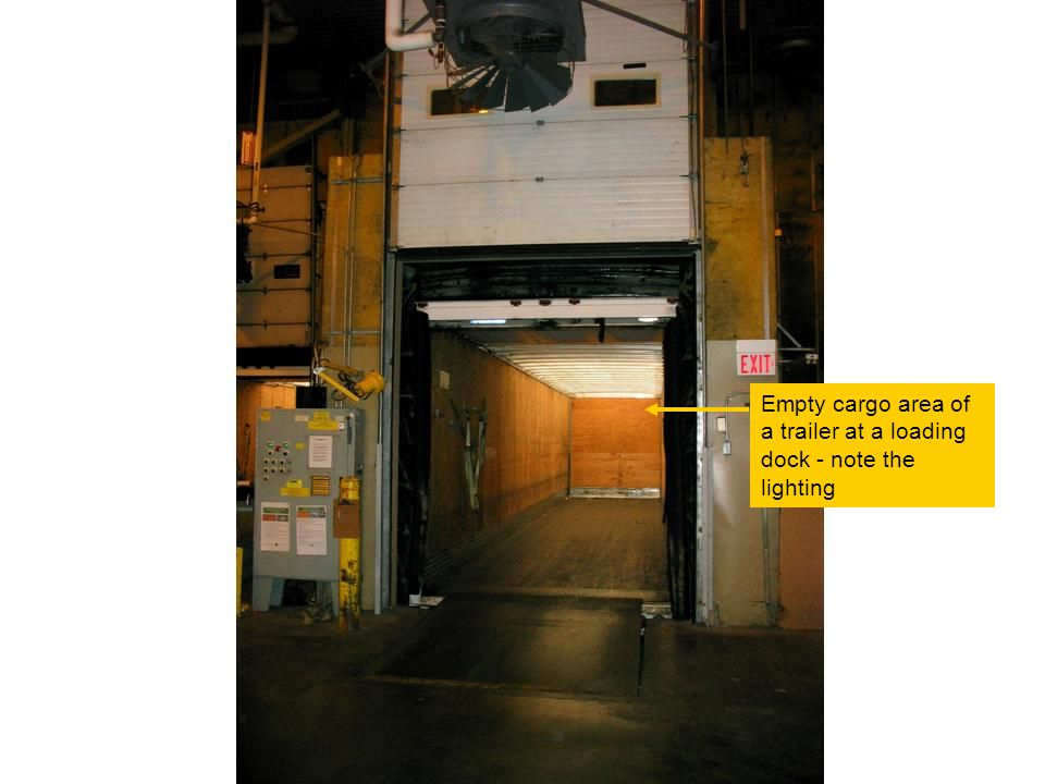 Empty cargo area of a trailer at a loading dock - note the lighting